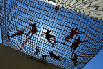 Third Place | General NewsScott Muthersbaugh, Burlington Times-NewsRunners scramble over a cargo net suspended more than 20 feet in the air during the Rugged Maniac 5k at Asheboro's Zoo City Mororsports Complex Saturday.