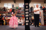 First Place | FeatureMike Spencer, The Wilmington Star-NewsShania Saeli, 7, sings the national anthem as boxing referee Bill Stankowski places his hand over his heart at the North Carolina Azalea Festival Boxing Tournament at Williston Middle School Saturday, April 13, 2103.