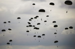 First Place | Multiple PhotosJames Robinson, The Fayetteville ObserverParatroopers prepare to land at Normandy Drop Zone.