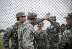First Place | Multiple PhotosMelvin-Rodriguez, The Fayetteville ObserverWestover High School Junior ROTC cadets give a high five through a fence before competing in their first event, One Rope Bridge, during the Raider Competition at Westover High School.