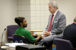 Third Place | Multiple PhotosJames Robinson, The Fayetteville ObserverDefense Attorney Butch Pope talks with  Mario McNeill before the start of court Wednesday morning.