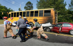 Second Place | Spot NewsMark Dolejs, Daily DispatchThe driver of a 2002 Mercury sedan is being charged with failure to reduce speed and non-alcohol driving while impaired after colliding into the back of a stopped school bus at the intersection of Vance Academy Road and Oxford Road.