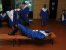 Second Place | General  NewsGray Whitley, The Wilson TimesGraduating senior George Mitchell catches a quick nap as fellow graduation candidates ready for the 2013 Commencement Exercise at James B. Hunt High School, June 8, 2013.