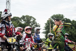 First Place | Multiple PhotosMelissa Melvin-Rodriguez, The Fayetteville ObserverJustin Posey explains an exercise before riders take their turn during a skills clinic at the BMX park at Tanglewood BMX Park.