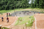 First Place | Multiple PhotosMelissa Melvin-Rodriguez, The Fayetteville ObserverRiders run through the track during a skills clinic at the BMX park at Tanglewood.
