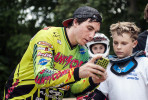 First Place | Multiple PhotosMelissa Melvin-Rodriguez, The Fayetteville ObserverJustin Posey (left) shows Caleb Horton, 10, (right) a video of his gate start while giving advice on how to improve during a skills clinic at the BMX park at Tanglewood.