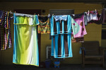 Second Place | Multiple PhotosJames Robinson, The Fayetteville ObserverDrying towels and bathing suits hang on a line at a hotel in White Lake.