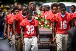 Third Place | General  NewsAndrew Craft, The Fayetteville ObserverJudges' comments:This is predictable and obvious, but clean.Members of the Seventy-First High School football team carry the casket of their teammate and friend Evan Raines at Kingdom Impact Global Ministries in Fayetteville, N.C. Raines died Saturday after collapsing on the school's football practice field.