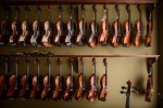 Third Place | FeatureAndrew Craft, The Fayetteville ObserverJudges' comments:Elegant. Well seen.Violins hangs from a rack at SG Music Company in Pittsboro.