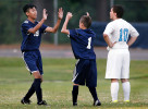Honorable Mention I SportsMark Dolejs, Daily DispatchNorthern Vance's Irving Cheluca (left) is congratulated by teammate Augustin Escamila after the first of two goals scored by Cheluca in their game at Southern Vance.