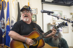 First Place | Multiple PhotosMelissa Melvin-Rodriguez, Carolina PanthersVietnam veteran Keith Lynch plays his guitar and sings on a Saturday morning at Richard's Coffee Shop in downtown Mooresville on September 21, 2013. Lynch spent four months in a hospital in Nashville, TN, to undergo a bone marrow transplant. While he was in the hospital and unable to come to Richard's, fellow patrons would call him and leave a phone on while they played so he could still be part of the music.