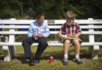 Third Place | Multiple PhotosJames Robinson, The Fayetteville ObserverIsiah Stefanelli, 9 and Wesley Robertson, 7, eat during the 225th Homecoming at Bethesda Presbyterian Church in Aberdeen.