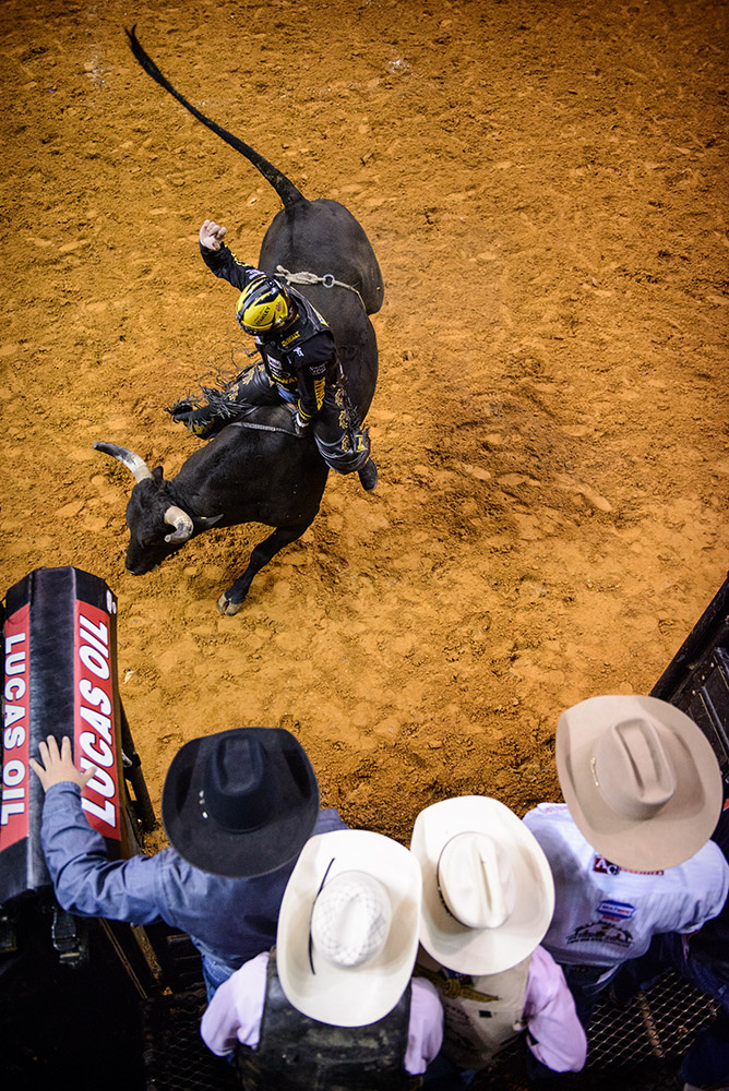 Third Place | SportsAndrew Craft, The Fayetteville ObserverJudges Comments: Third place is a well-composed rodeo shot that we haven't seen before. Any photographer can shoot the action but adding a little fun context takes thought.Austin Meier rides {quote}Little Bighorn{quote} Saturday night at The Fort Bragg Wounded Soldier Foundation PBR Invitational in the Crown Coliseum.