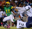 Honorable Mention I SportsScott Muthersbaugh, Burlington Times-NewsJudges Comments: Honorable mention could be a lead image for a high school football game but did not stack up against the first through third pictures. Western Alamance's T.J. Harris loses his helmet as he and teammate D.J. Elliott sack Eastern Alamance's John Lamot during the game at Eastern Alamance Friday.