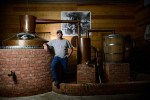 Second Place | PortraitAndrew Craft, The Fayetteville ObserverJudges Comments: It's easy to tell that the photographer took the time in the second place image to compose and light the frame until they nailed it. There are no flaws but it does not have the same feeling as the first place winner. Jeremy Norris, owner of Broadslab Distillery, stands next to his distiller in Benson.