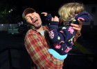 First Place | Multiple PhotosAl Drago, Elon UniversityStephen Shrum makes a face as he is slapped by his daughter, Phoenix, just after waking up Thursday morning to go to work. When he goes to work, Phoenix spends the remaining two hours of her mother's shift at the Daniel Pitino Shelter with her.