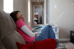First Place | Multiple PhotosAl Drago, Elon UniversityShelly Shrum takes a nap after her daughter, Phoenix, fell asleep watching {quote}Barney & Friends{quote} in their living room.