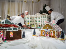 Second Place | Multiple PhotosTimothy Hale, FreelanceChef Joey Norombaba, right, resort pastry chef, helps guide the main center piece, The Carolina Hotel, for the gingerbread village at The Carolina Hotel in Pinehurst, N.C., Nov. 25, 2013. The finished village is comprised of gingerbread, sugar, and pastillage depicting iconic building in the village of Pinehurst.
