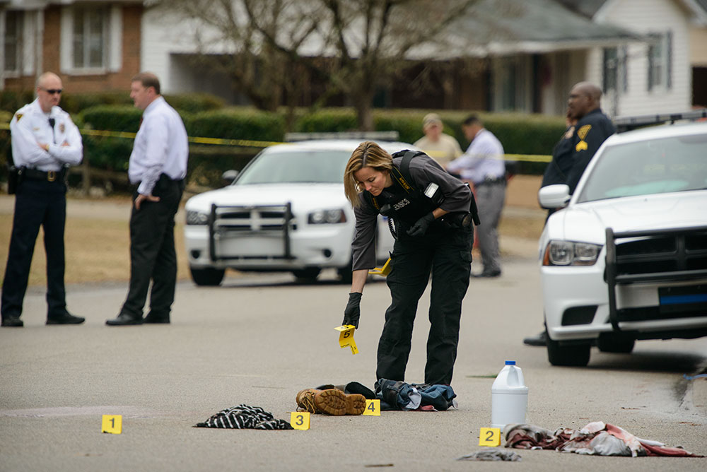 Third Place | Spot NewsAndrew Craft, The Fayetteville ObserverThis is not the peak of breaking news action, but it is a very good illustration of the aftermath. Subtlety is often a more powerful storytelling tool than the obvious. A forensic investigator places evidence markers on the ground at the scene of a shooting Wednesday, December 4, 2013, on Cheltenham Road.