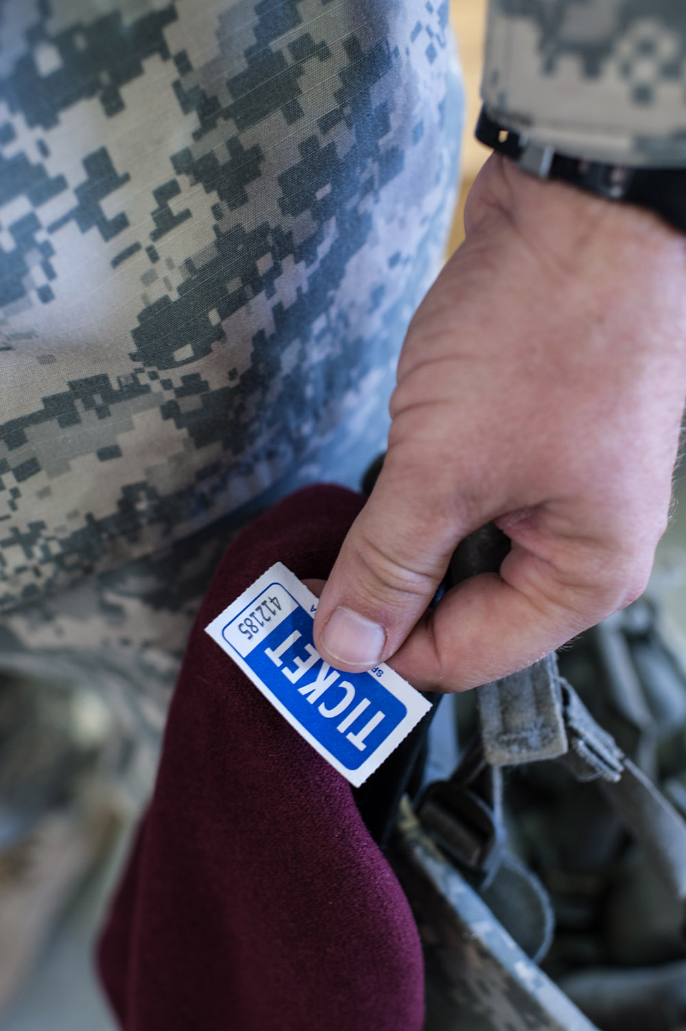 Second Place | Multiple PhotosTimothy HaleA soldier keeps his ticket at the ready in the hopes of hearing his number called during the 16th Annual Randy Oler Memorial Operation Toy Drop, at Green Ramp, Pope Army Airfield, Fort Bragg, N.C., Dec. 6, 2013. The first phase of Toy Drop includes bringing in an unwrapped toy to receive a ticket. The tickets are then randomly drawn to earn the seat for tomorrow's airborne operation at Sicily Drop Zone. Last year, Operation Toy Drop collected more than 12,000 toys which were donated to charities and organizations across North Carolina.