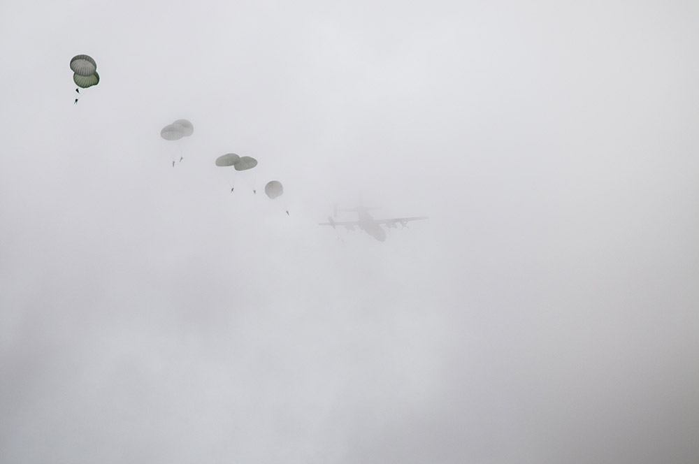 Second Place | Multiple PhotosTimothy HaleParatroopers exit a U.S. Air Force C-130 Hercules shrouded in clouds during the 16th Annual Randy Oler Memorial Operation Toy Drop, at Sicily Drop Zone, Fort Bragg, N.C., Dec. 7, 2013. While the weather did not cooperate earlier in the day, the rain subsided around midday allowing hundreds of paratroopers to complete their jumps and earn their foreign jump wings while supporting area children in need with a new unwrapped toy. The C-130 is equipped with Adverse Weather Aerial Delivery system allowing the paratroopers to jump in less than ideal conditions.