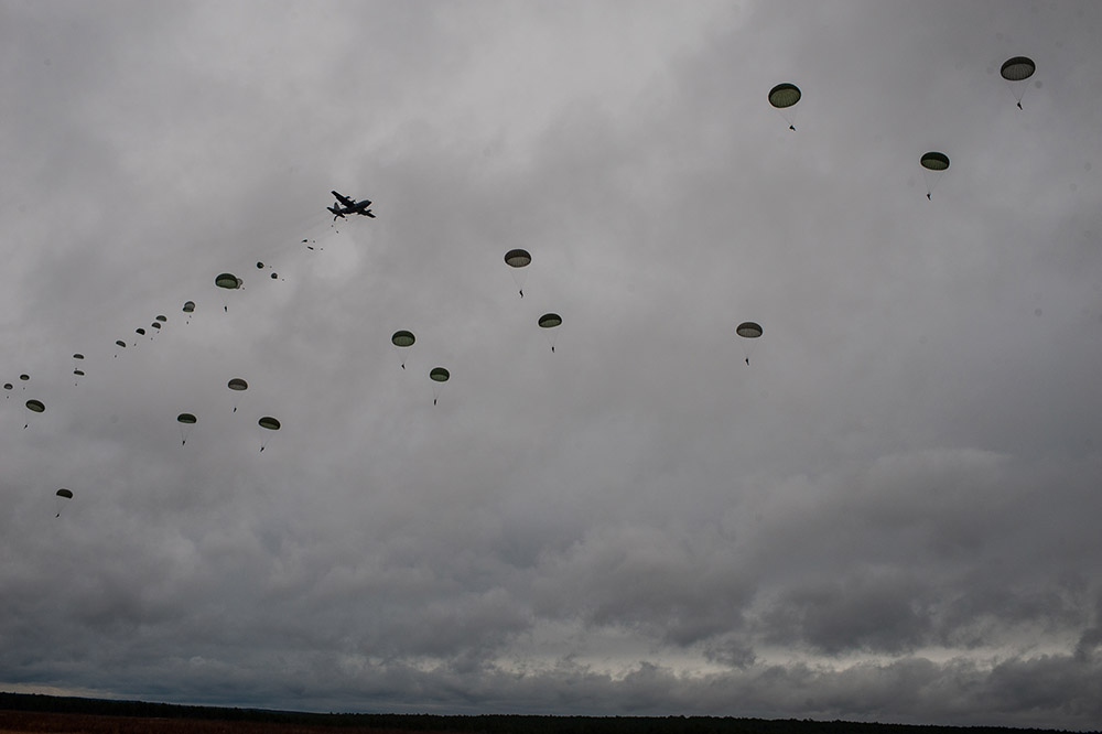 Second Place | Multiple PhotosTimothy HaleParatroopers descend from a U.S. Air Force C-130 Hercules during the 16th Annual Randy Oler Memorial Operation Toy Drop, at Sicily Drop Zone, Fort Bragg, N.C., Dec. 7, 2013. While the weather did not cooperate earlier in the day, the rain subsided around midday allowing hundreds of paratroopers to complete their jumps and earn their foreign jump wings while supporting area children in need with a new unwrapped toy.