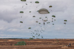 Second Place | Multiple PhotosTimothy HaleParatroopers descend on Sicily Drop Zone during the 16th Annual Randy Oler Memorial Operation Toy Drop, at Fort Bragg, N.C., Dec. 7, 2013. While the weather did not cooperate earlier in the day, the rain subsided around midday allowing hundreds of paratroopers to complete their jumps and earn their foreign jump wings while supporting area children in need with a new unwrapped toy.