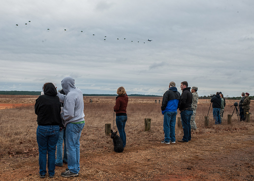 Second Place | Multiple PhotosTimothy HaleFamilies watch as paratroopers descend on Sicily Drop Zone during the 16th Annual Randy Oler Memorial Operation Toy Drop, at Fort Bragg, N.C., Dec. 7, 2013. While the weather did not cooperate earlier in the day, the rain subsided around midday allowing hundreds of paratroopers to complete their jumps and earn their foreign jump wings while supporting area children in need with a new unwrapped toy.