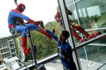 First Place | Feature Ethan Hyman, The News & ObserverJacob Smith 10, of Raleigh, greets Spider-Man, who is played by Marcos Medrano, through the window as window washers from Scottie's Building Services drop in to greet patients of WakeMed's Children's Hospital Tuesday, April 23, 2013.  Spider-Man, Batman and Iron Man spent the day outside the windows of the lobby and children's rooms.  {quote}It's awesome{quote} said Smith, who has been in the hospital two nights, of the superhero visit.