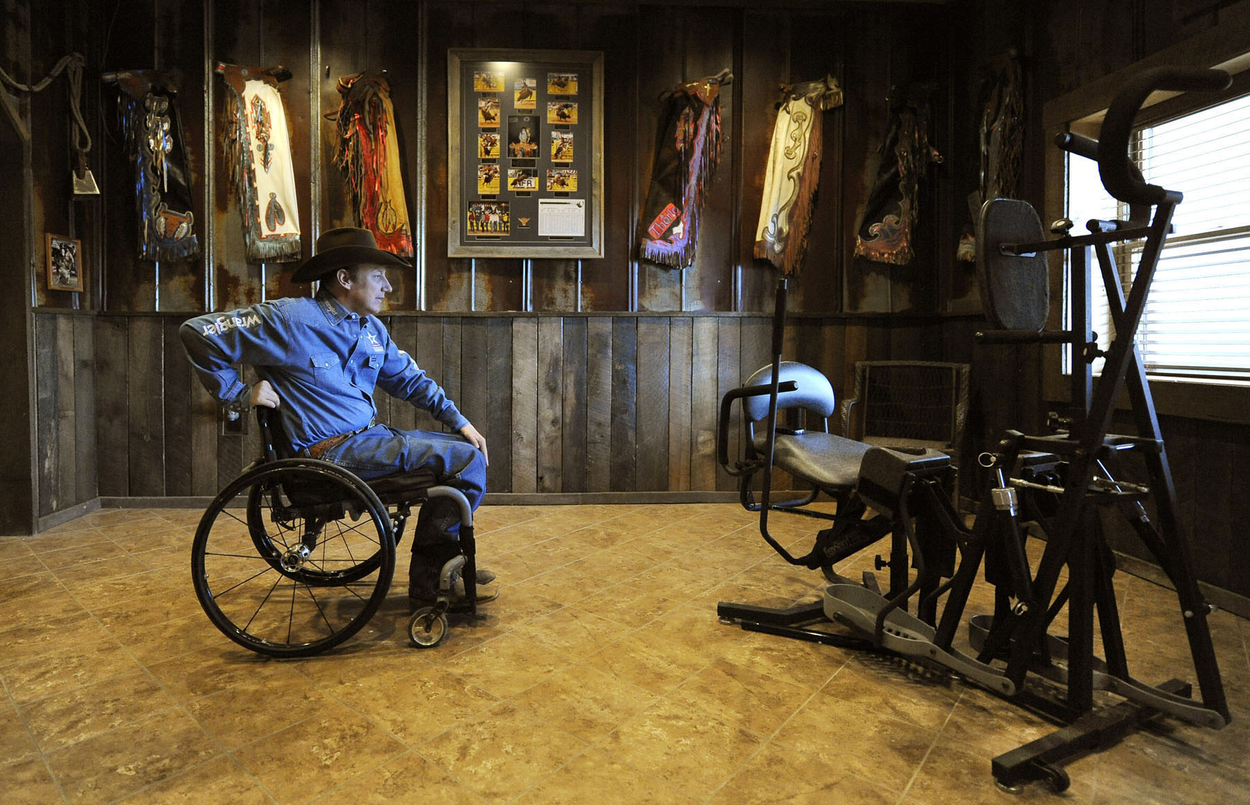 Honorable Mention | PortraitJeff Siner, The Charlotte ObserverJerome Davis was one of the best bull riders and rodeo cowboys in the country when he was thrown from a bull breaking his neck. The injury has left him with paralysis from the chest down. Davis tries to use the standing frame an hour a day. Jeff Siner - jsiner@charlotteobserver.com