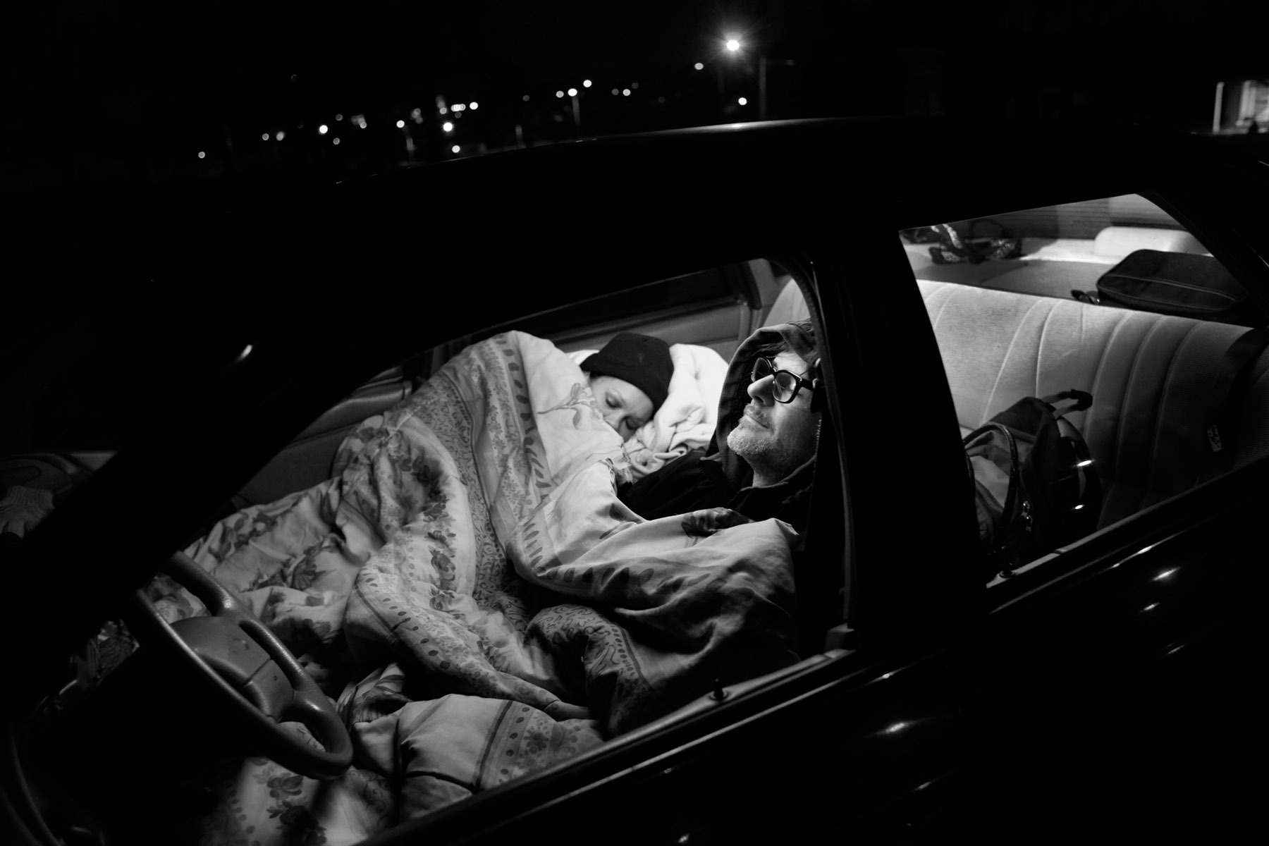 First Place | News Photo Story Travis Long, The News & ObserverCharmain Williams, left, and her boyfriend Milton Horton sleep in sub-freezing weather inside Horton's 1994 Ford Taurus Wednesday, January 23, 2013, in a city park in Raleigh. The couple have been homeless for four months living in their car and eating at soup kitchens. Horton says he's been struggling to keep consistent employment for 5 years.