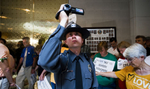 Second Place | News Photo StoryAndrew Dye, Winston-Salem JournalA police officer with the General Assembly police films journalists and protestors at the seventh Moral Monday protest on June 17, 2013 in Raleigh, N.C.