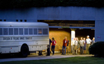 Second Place | News Photo StoryAndrew Dye, Winston-Salem JournalProtesters arrested at the tenth Moral Monday are loaded into a division of prisons bus out of the N.C. Legislature basement.