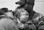 Honorable Mention | News Photo Story Al Drago, Elon University Phoenix laughs with her baby doll as she is hugged and kissed by her parents, Shelly and Stephen, before he heads to work early Friday morning.