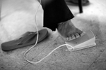 Honorable Mention | Feature Photo Story Jerry Wolford, News & RecordGwen White likes to use her bare foot on the pedal that operates the sewing machine. White says she has more control with her stitches by kicking off her shoes.