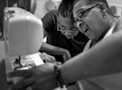 Honorable Mention | Feature Photo Story Jerry Wolford, News & RecordLoretta McQueen, left, and Gwen White bump heads when leaning toward each other while struggling with a sewing machine.