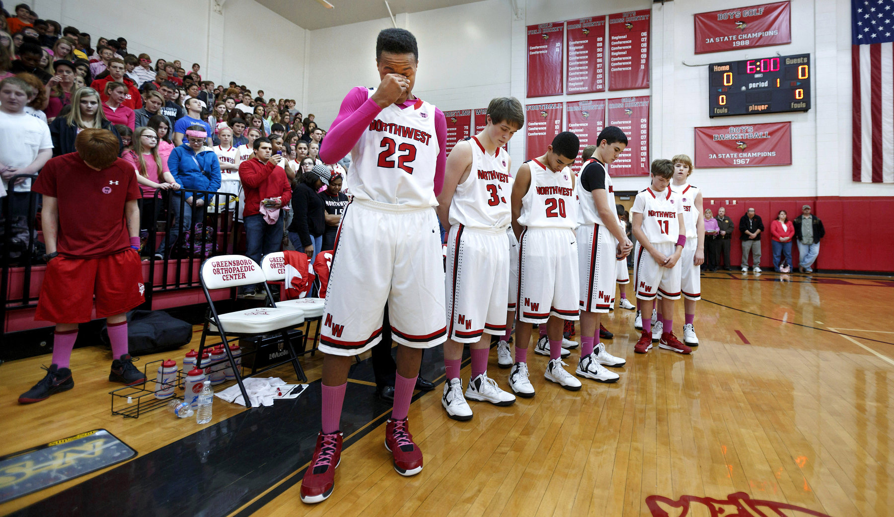 Second Place | Sports Photo Story Jerry Wolford, News & RecordNorthwest Guilford Middle School boys during a moment of silence taken for Maurice Edmonds II before their game against Jamestown which was the team's first game after Maurice's death.