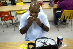 POY: Runner UpTravis Long, The News & ObserverFloyd Brown, an Anson County man with an IQ of 50, eats the bologna sandwich he packed in his lunch  while visiting the McLaurin Vocational Training Center for the developmentally disabled in Hamlet. The state agreed to pay $7.85 million to settle the state lawsuit filed by Brown after he was locked up for 14 years in a psychiatric hospital based on what his lawyers said was a false murder confession created out of whole cloth by an SBI agent.