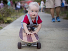 Student Photographer of the YearJill Knight, The News & ObserverFifteen-month-old James Hodge rides a longboard down a sidewalk during Party in the Peak Sunday October 6, 2013 in Apex, N.C. The celebration was held after Money Magazine recently ranked Apex #9 Best Place to Live in America and the #1 Best Place in North Carolina. Hodge does yet walk but learned to ride his father's longboard a few months ago. nycpr