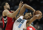 Sports POY: Runner UpJeff Siner, The Charlotte ObserverCharlotte Bobcats Gerald Henderson fights to maintain control of the ball as Toronto Raptors Landry Fields applies defensive pressure.
