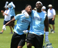 Sports POY: Runner UpJeff Siner, The Charlotte Observer(L-R) Dorman Cavaliers Ricus Askew and Wesley Robinson celebrate their team's 24-21 victory over Mallard Creek in the Carolina Panthers 7-on-7.