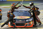 Sports POY: Runner UpJeff Siner, The Charlotte ObserverMembers of NASCAR Sprint Cup Series driver Tony Stewart's team hand the jack over the top of the car during Sprint All-Star Race qualifying.
