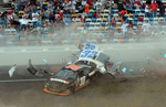 Sports POY: Runner UpJeff Siner, The Charlotte ObserverNASCAR Nationwide Series driver Kyle Larson's car disintegrates with debris flying into the stands after being involved in a wreck with Brad Keselowski and Brian Scott.