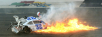 Sports POY: Runner UpJeff Siner, The Charlotte ObserverNASCAR Nationwide Series driver Kyle Larson's car catches on fire as he slides down the front stretch after a wreck with Brad Keselowski and Brian Scott.