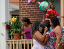 Second Place | Spot News Al Drago, Elon UniversityNina Epps, 21, right, is consoled by a family member after mourning the loss of her 3-year-old daughter McKenzie Elliott, who was killed by a stray bullet on the 3600 block of Old York Road Friday afternoon.