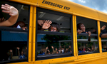 First Place | General News Jerry Wolford, News & RecordWaving teachers are reflected in the school bus windows as students express a mix of tears and cheers as Falkener Elementary school students leave school on the bus on the last day of the year.