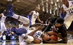First Place | SportsEthan Hyman, The News & ObserverFlorida State\'s Okaro White (10) fights with Duke\'s Tyler Thornton (3) for the ball during the first half of Duke\'s game against Florida State at Cameron Indoor Stadium in Durham, N.C., Saturday, January 25, 2014.
