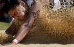 Third Place | Sports Scott Muthersbaugh, Perfecta VisualsWilliams High School\'s Tamilia Wright crashes into the sand at the end of her long jump at the 3A State Track and Field Championships at A&T State University in Greensboro Friday. Wright placed third in the event.