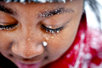 Honorable Mention | Pictorial Lauren Carroll, Winston-Salem JournalSnowflakes cling to nine-year-old Tamya Hardy\'s eyelashes as she plays in the snow with friends at Cambridge Apartments on 23rd Street Tuesday, January 28, 2014.