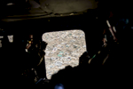 Third Place | News Photo Story Andrew Craft, The Fayetteville ObserverSoldiers snap pictures of Kabul, Afghanistan as they flyover it, May 11, 2015. This is the way a majority of soldiers now get to see Afghanistan outside of the NATO bases.